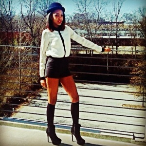 Love her outfit! Actually reminds me of a trick for my fellow skinny girls. If you want that tall boot look but having trouble finding a pair that don't swallow your legs, wear a pair of long socks with booties like Gaylyn and it'll give a similar effect!